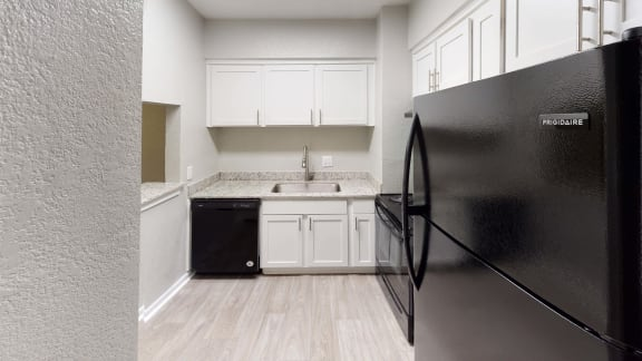 Kitchen with appliances at The Life at Beverly Palms, Texas