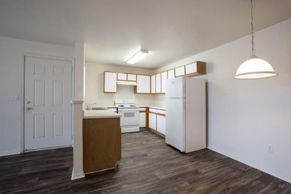 Kitchen & Dining Area at Aspen Ridge Apartments in Albuquerque, NM