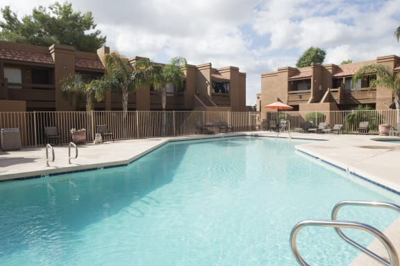 Pool & Pool Patio at Sunset Landing Apartments in Glendale, AZ