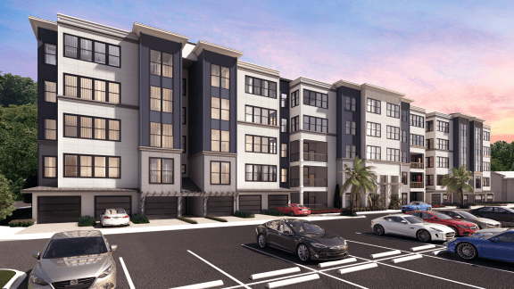 Exterior view of The Pointe of Westshore apartments for rent and parking lot in Tampa, FL