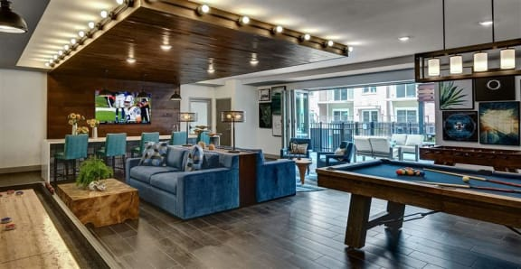 Buckingham Place Apartments Resident Clubhouse with Ample Seating, TV, and Billiards Table
