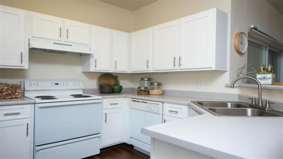Village at Main Street | Spacious Kitchen with White Cabinetry and White Appliances