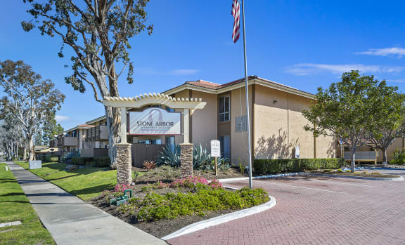 Apartments for Rent Oceanside CA - Spacious Lounge Room Featuring Long Couch and a Bar