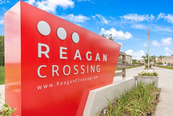 Front entrance sign at Reagan Crossing in Covington, LA