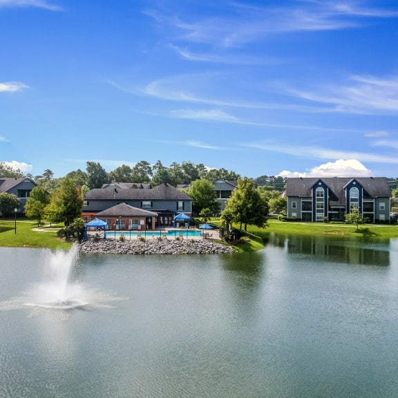 Aerial view of Pelican Pointe apartments for rent in Slidell, LA with large pond surrounded by community buildings