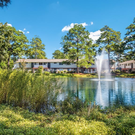 Looking across the stocked fishing pond towards the property at Ascend at Savannah