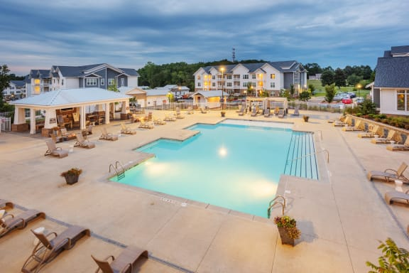 Aerial view of the Station at Poplar Tent swimming pool, sundeck, and outdoor social area in Concord, NC