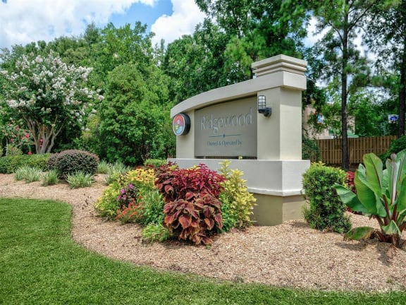 Landscaping and entrance sign to Ridgewood apartments for rent in Savannah, GA