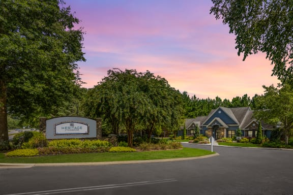 Property entrance with lush landscaping at Heritage at Riverstone apartments for rent in Canton, GA