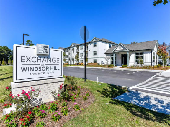 Entrance sign at Exchange at Windsor Hill and exterior of the leasing office in North Charleston, SC