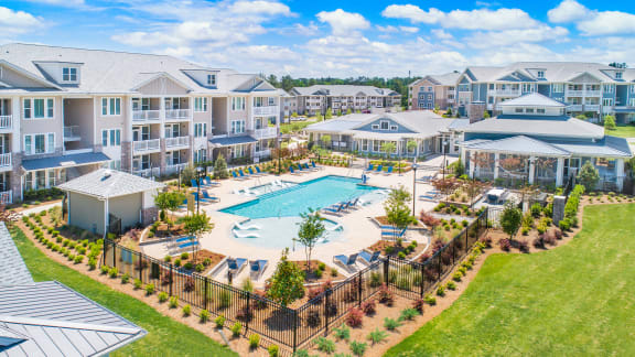 Aerial view of The Highland apartment community with resort-style swimming pool and amenities in Augusta, GA
