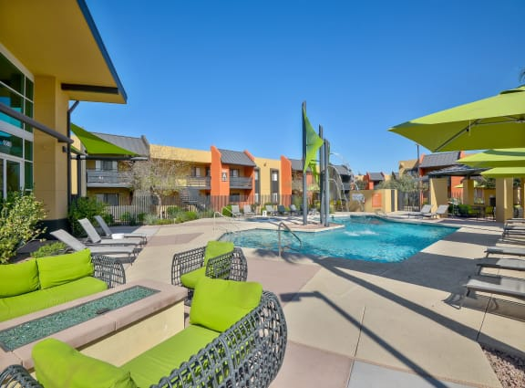 Sparkling resort-style pool and lounging area at Onnix Apartments in Tempe, AZ