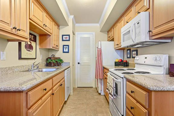 Fully Equipped Kitchen Includes Frost-Free Refrigerator, Electric Range, & Dishwasher at Clayton Creek Apartments, Concord, CA, 94521