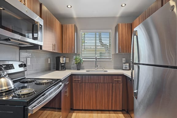 Refrigerator And Kitchen Appliances at Colonial Garden Apartments, California