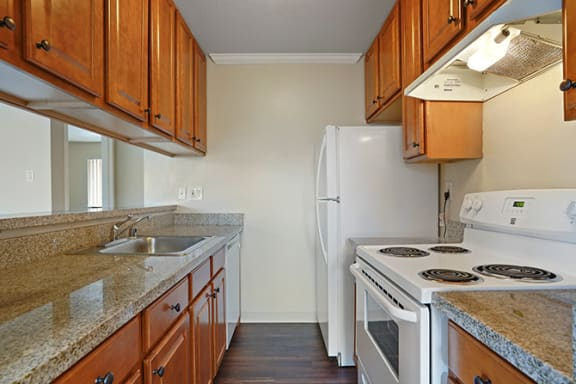 Fully Equipped Kitchen Includes Frost-Free Refrigerator, Electric Range, & Dishwasher at Fairmont Apartments, Pacifica, 94044