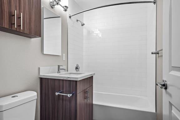 Renovated Bathrooms With Quartz Counters at Peninsula Pines Apartments, South San Francisco, CA