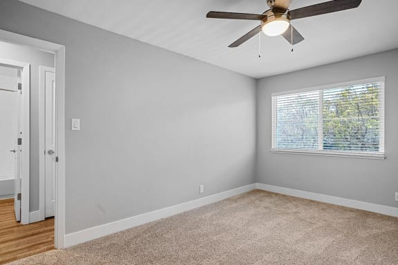 Bedroom With Ceiling Fan at Peninsula Pines Apartments, California, 94080