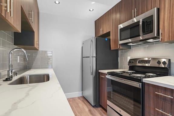 Granite Countertop Kitchen at Peninsula Pines Apartments, South San Francisco, California