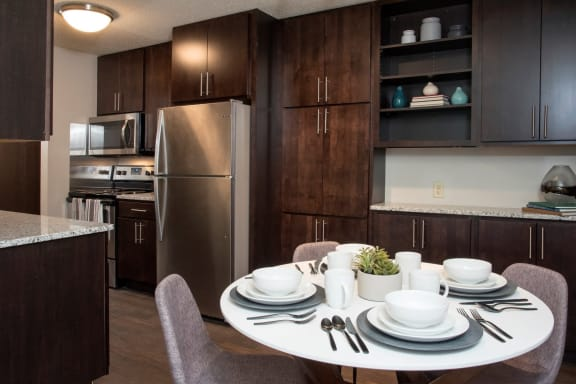 Extended kitchen cabinetry at Aspenwoods Apartments, Eagan, MN