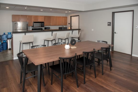 community room with seating and kitchen