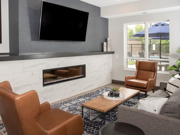 Community room lounge with fire place and tv