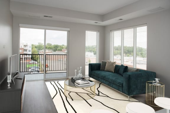 Joel 1 bedroom, living room with floor to ceiling windows and balcony