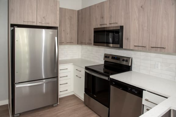 Nordic kitchen with stainless steel, quartz countertops, two-toned cabinets