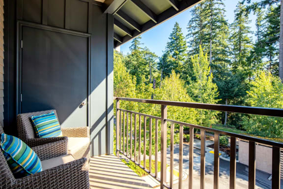 balcony overlooking green pine landscaping at  Discovery Heights in Issaquah, Washington