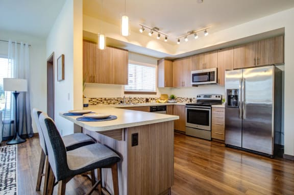 Fully equipped kitchen at Discovery West Apartments in  Issaquah, WA
