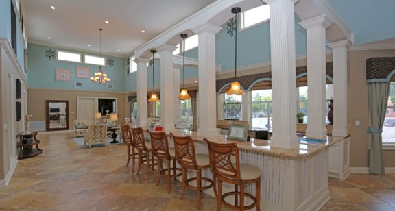 Elegant clubhouse with bar seating at The Columns at Bear Creek, New Port Richey, FL 34654