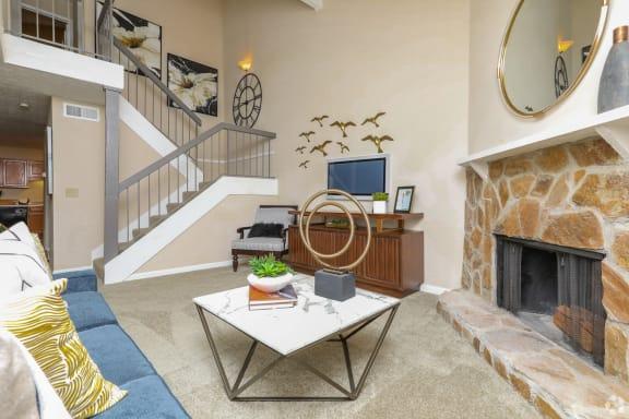 Inviting living room with stone fireplace and staircase, The Columns at Lake Ridge, 3900 Lake Ridge Lane, Dunwoody, Georgia 30338