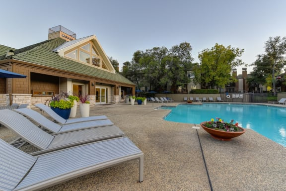 Swimming Pool with Lounge Chairs around the deck area.  This is one of three swimming pools on-site.