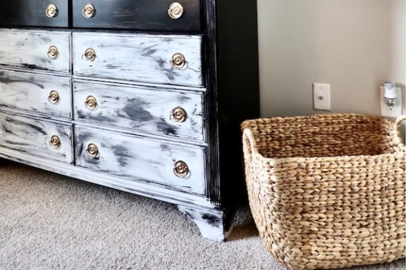 Plush carpet in bedroom with chest and basket