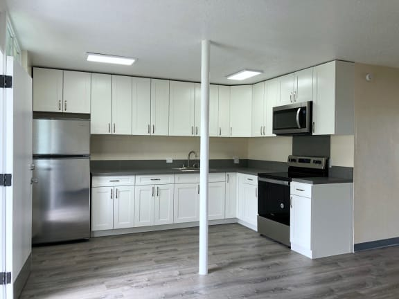 Hale Makiki Apartments kitchen area with appliances and cabinets