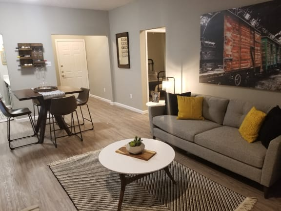 Oakwood Creek Apartments living and dining area with decor