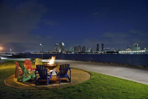 Fire pit seating by the bay l Coronado on the Bay Apartments in Coronado CA