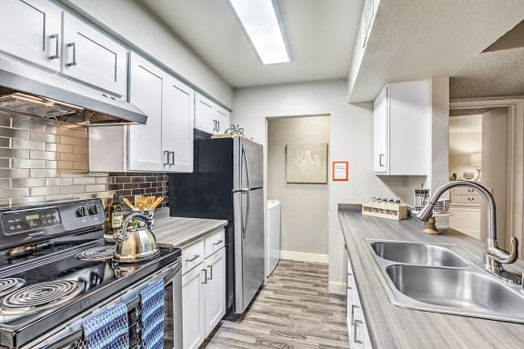 Apartments for Rent in Las Vegas - St. Lucia Kitchen With Stainless Steel Appliances, Sleek Cabinetry, Hardwood Style Floors, and Modern Finishes
