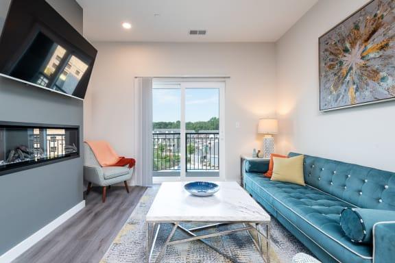 Millside living room model open floor plan balcony and wood finish flooring wide plank