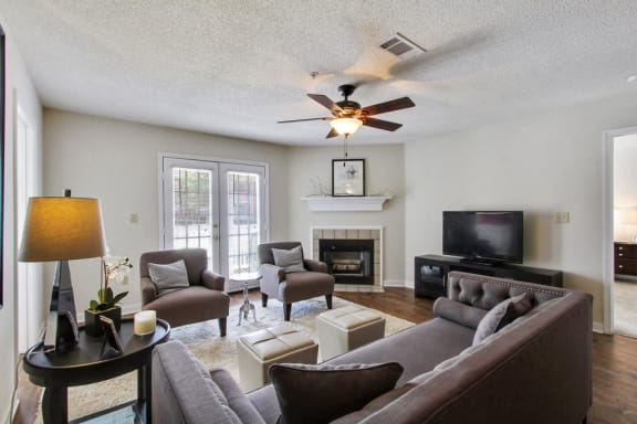 Open Living Room with a Fireplace at Reserve at Woodchase Apartment Homes, Clinton, Mississippi, 39056