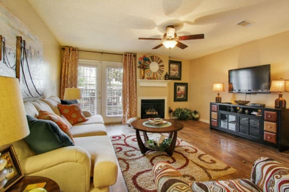 Living Room with Television at Reserve of Jackson Apartment Homes