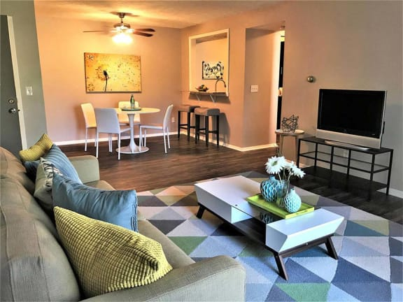 Large, modern living room with adjacent dining room at Camelot East Apartments in Fairfield, OH 45014
