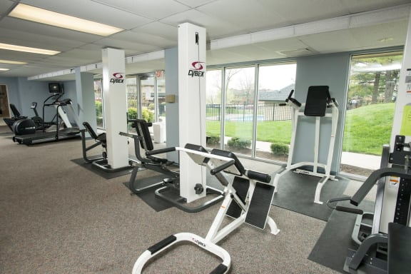 Fitness center with cardio and weightlifting equipment at Olde Towne Apartments in Middletown, OH