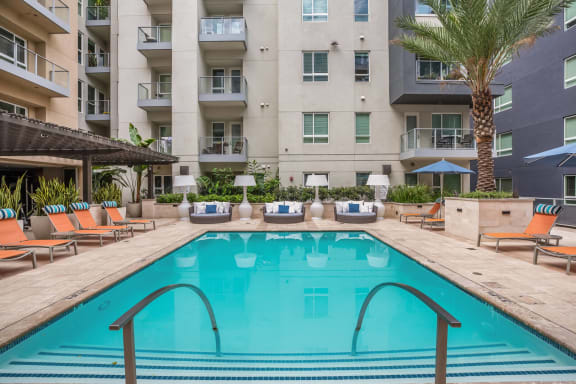 Resort-Style Swimming Pool with Sundeck Cabanas at South Park by Windsor, Los Angeles, California