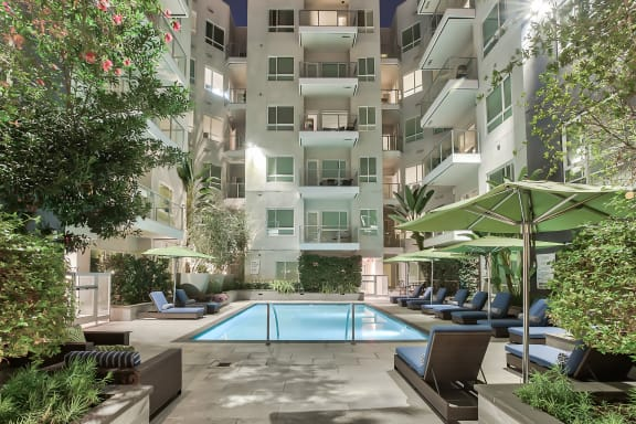 Courtyard with pool at night at Olympic by Windsor, 936 S. Olive St, 90015