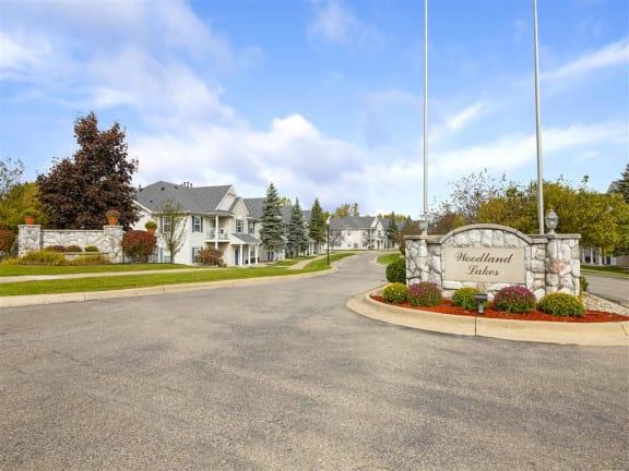 Welcoming Property Signage at Woodland Lakes Apartments, Lansing, MI