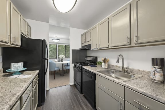 kitchen at Seven Springs apartments in College Park MD with new black appliances and light gray cabinets