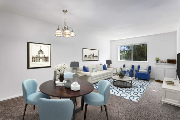 living room at Creekside at Tasker's Chance in Frederick, MD with dining area with four chairs, couch, chairs, coffee table, cabinet storage and area rug
