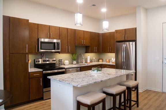 Gourmet Kitchen With Island at The Residences at Park Place, Leawood, KS