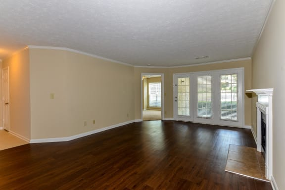 Living Room with Wood Style Flooring at Wynfield Trace, Peachtree Corners, Georgia