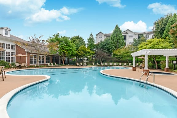 Swimming Pool With Relaxing Sundecks at Riverstone at Owings Mills Apartments, Maryland